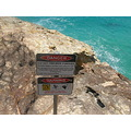 australia stradbroke island rocks coast sea warning