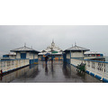 Llandudno pier Winter friends in rain