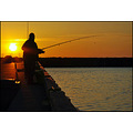 sunset fishing man harbour harbor orange sea pier evening silhouette