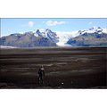 iceland travel landscape glacier ice volcano black sand man people