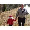 Picture of my daddy walking with my granddaughter & his little dog CoCo in his coat.  CoCo loved ...