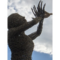willow wicker tree man woman people craft sky blue clouds silhouette