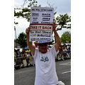 mermaid parade coneyisland brooklyn newyork protester sign