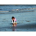 KID fion irish red hair curly 2 years litle mud playing boy game sea girl sand