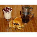 Baked milk with cherries , french press coffee and pappy seed rolls