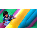 Child on inflatable slide