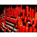 Red candles cathedral barcelona spain