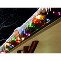 ICECICLES REFLECTING OFF OF THE CHRISTMAS LIGHTS FROM THE EVE OF OUR LITTLE CABIN