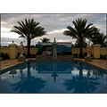 pool water statue sky cloud shadows reflection surreal abstract