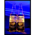 One black sheet for the background, two unopened bottles of Corono, one small flashlight for back...