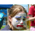 sad clown girl face facepaint closeup