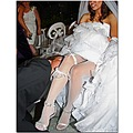 wedding bride groom legs garter reception