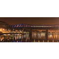 "The ""Queen Elizabeth 2nd"" bridge across the river Tyne. The white streak is a metro train crossin..."