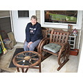 Ruth enjoying her new bistro set on the back porch.