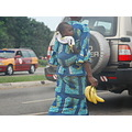 ghana accra street road car traffic food banana child