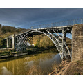 The Iron Bridge The Iron Bridge crosses the River Severn in Shropshire, England. It was the firs...
