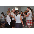 Our grand daughter  (in the red and white kilt) works with some of the younger members of the fid...