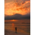 Taken in Singapore Beach, Punggol Marina. A kid throwing a rock to the sunset.