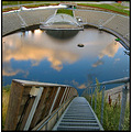ski jump skiing blue stairs water sports down arena reflection sky cloud