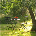 garden chair table rain sunset