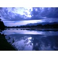 blue reflection nature waters light clouds sun sky dawn sunrise sea seri