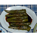 Steamed stuffed green chillies with black vinegar.