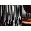 Organ practice on Thursdays. The door to the pipes was open....