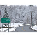snow highway roadsign trees landscape