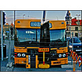 yellow bus downtown knife public transport cut art sign car half split