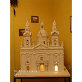 A miniature model of the Parish church of Luqa in Malta made from Maltese stone.