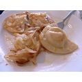 Pierogis filled with mashed potatoes and sauerkraut, then fried in butter and onions .. for break...