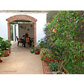 Archway terrace flowers garden home Alora Andalucia Spain