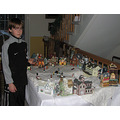 Setting up the Christmas Village is my 11 years old grandsons job He can hara