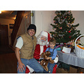 Santa made an appearance, so the pastor's son joined wee little Charley on Santa's lap. (Mike Jr....