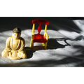 buddha rocking chair shadow sunlight meditation zen pognyc