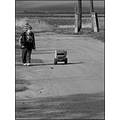 street road field pylon shadow children car game artistic bw