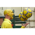 juggler man with yellow head