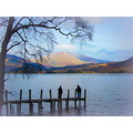 Waiting for the ferry on the pier at Derwent Water Cumbria.