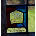 a small stain glass window inside the church