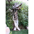 statue tree trunk chained man art of mrs nahla salti