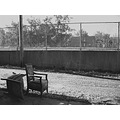 chairs trash garbage alley chainlink fence blackwhite bw