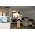 looks like a mother and son!  but not!!  the boy is the brother of the one which weara red T ...