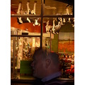 amsterdam wierd man in window upside down cows shop street