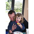 Lauren with Uncle Andrew, eating cousin Sophie's birthday cake.