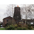 "8. We stayed overnight in Arties Mill - complete with Winnie the Pooh Santa on top of the ""chimney"""
