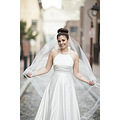 This one of a kind silhouette will get focus,Pleated strapless iridescent taffeta dress has unque...