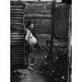 pregnant woman with a child in the slums in santa clara cuba