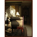 room carpet lamp divan fireplace statue vase wall painting surreal