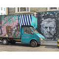 portabello road van truck colourful mural face peeling paint