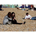 Brighton beach people pebbles